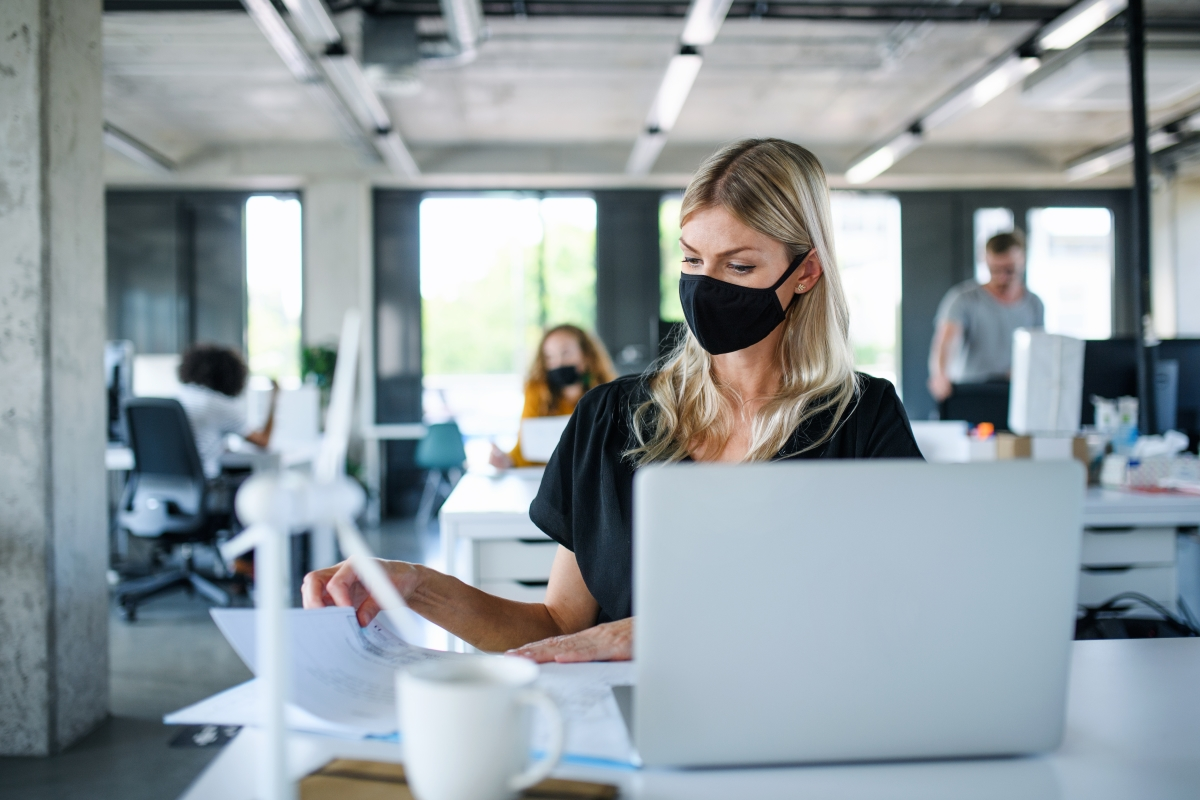 Woman at work with mask